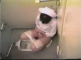 Japanese girl caught masturbating in the toilet