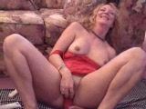 My wife playing with her big dildo