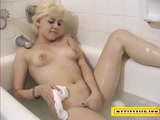 Blonde slut sucking a tiny dick in the bath tub
