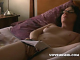 Geeky girl rubs her shaved pussy