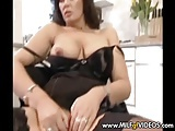 Busty MILF in black stockings toying with her shaved pussy