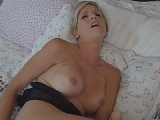 Blonde in a sexy lingerie plugging her ass and pussy