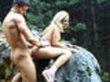Blonde Babe Gets Fucked Outside on a Rock