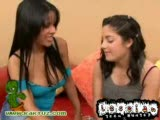 Two sexy teen lesbians playing with a dildo