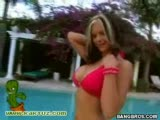 Cute chick gives a handjob at the poolside